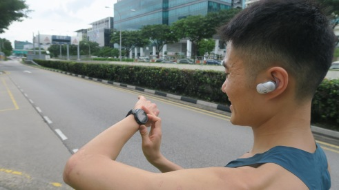 Mok Ying Ren using the Sony in-ear headphone